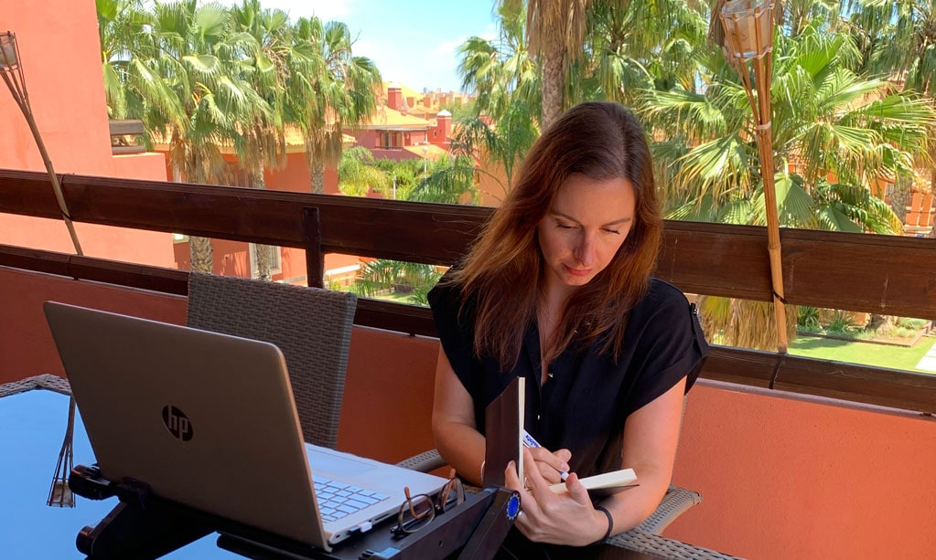 Healthcare PR freelancer working on a client project on her balcony in Spain